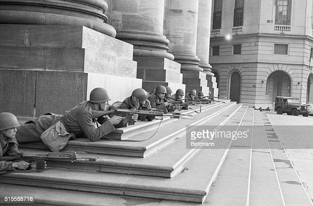 Argentine troops lay with rifles ready in the Plaza de Mayo across from the Presidential Palace awaiting developments as a military coup ousts the...