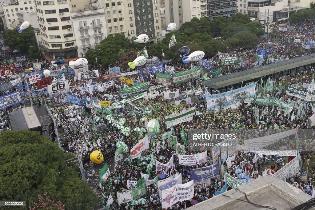 Argentine truckers and other labor unions and social organizations protest austerity measures adopted by the government of Mauricio Macri, in Buenos Aires on February 21, 2018. /