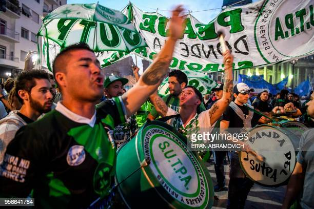 Argentine union members hold a demonstration while legislators debate a bill to put a stop on the rise of public services taxes outside the Congress...