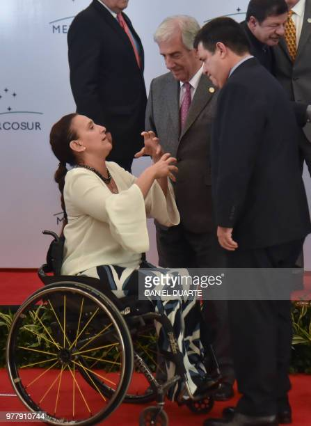 Argentine VicePresident Gabriela Michetti Uruguay's President Tabare Vazquez and Paraguay's President Horacio Cartes chat before posing for the...