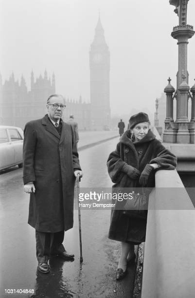 Argentine writer and poet Jorge Luis Borges pictured standing with his mother Leonor Acevedo Suarez on Westminster Bridge in London on 12th February...