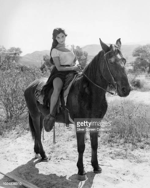 ArgentineAmerican actress Linda Cristal as Elena de la Madriaga in the film 'Two Rode Together' 1961