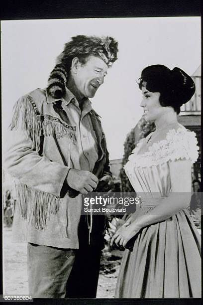 ArgentineAmerican actress Linda Cristal with American actor and director John Wayne on the set of his movie The Alamo