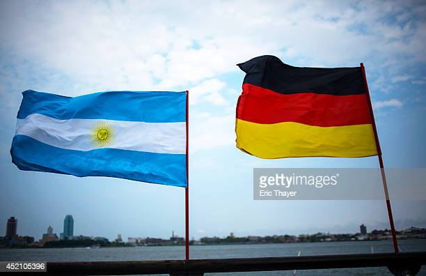 Argentinean and German flags fly at a watch party during the World Cup final match between Germany and Argentina July 13 2014 in New York City The...