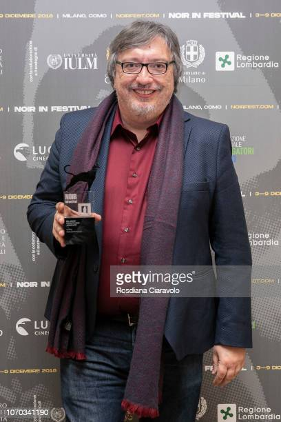 Argentinean author journalist and literary critic Sergio Olguin poses with The Black Panther 2018 award for Best Performance' at Noir In Festival on...