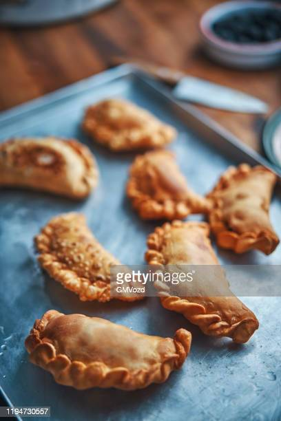 argentinean empanadas with meat and vegetables - empanada stock pictures, royalty-free photos & images