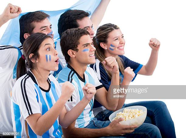 Argentinean football fans watching the game
