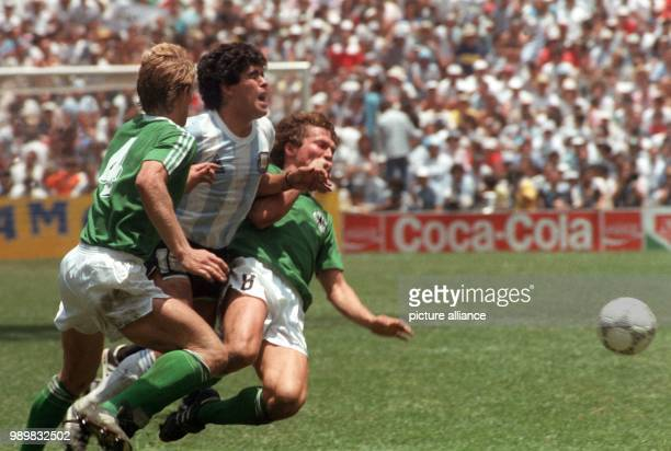 Argentinean soccer ace Diego Maradona is stopped by German players Karlheinz Foerster and Lothar Matthaeus during the World Cup final at Aztec...