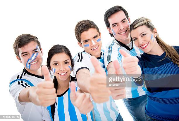 Argentinean soccer fans with thumbs up