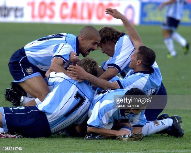 Argentinean soccer players Juan Veron Hernan Crespo Diego Simeono and Claudio Lopez hug each others after their third goal against Bolivia in a...