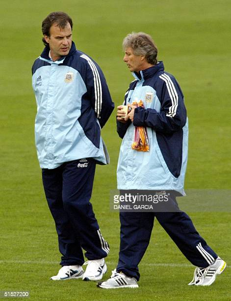 Argentine's coach Marcelo Bielsa talks to Argentines's national soccer team general manager JosT Pekerman after a friendly game against the Kashima...
