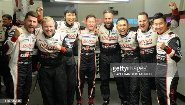 TOPSHOT Argentine's driver Jose Maria Lopez British's driver Mike Conway and Japan's driver Kamui Kobayashi and their mechanics and engineers of...