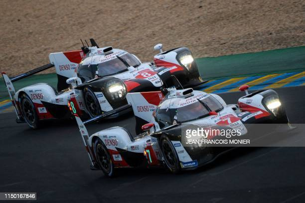 Argentine's driver Jose Maria Lopez on his Toyota TS050 Hybrid LMP1 N°7 fight for the lead with his teammate Japanese's driver Kazuki Nakajima on his...