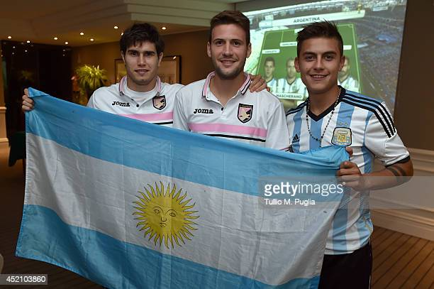 Argentines Ezequiel Munoz Franco Vazquez and Pulo Dybala show their support as they are going to watch on television the FIFA final betwen Germany...