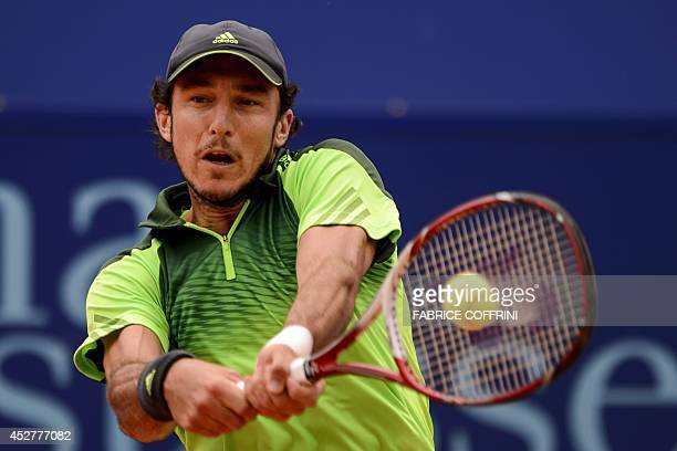 Argentine's Juan Monaco returns a ball to Spain's Pablo Andujar during their final at the Swiss Open ATP 250 tennis tournament on Juily 27 2014 in...