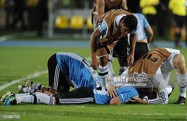 Argentine's players react at the end of the match against Portugal during their FIFA World Cup U20 football match at Jaime Moron Olimpic stadium in...