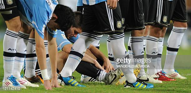 Argentine's players react at the end their FIFA World Cup U20 football match against Portugal at Jaime Moron Olimpic stadium in Cartagena Colombia on...