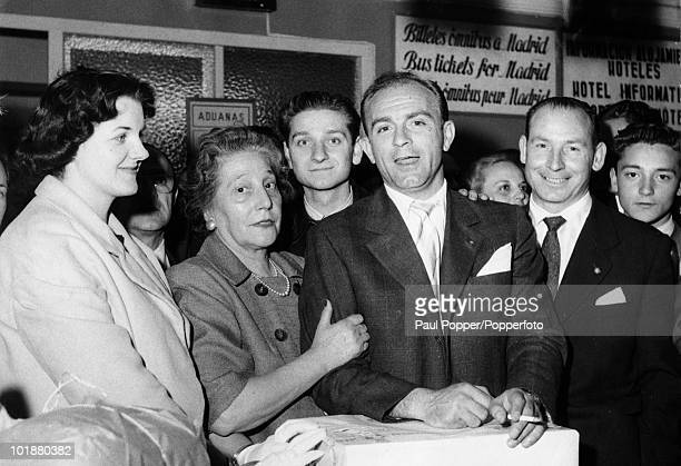 ArgentineSpanish footballer Alfredo di Stefano of Real Madrid at customs in Madrid Airport with his wife 30th May 1958