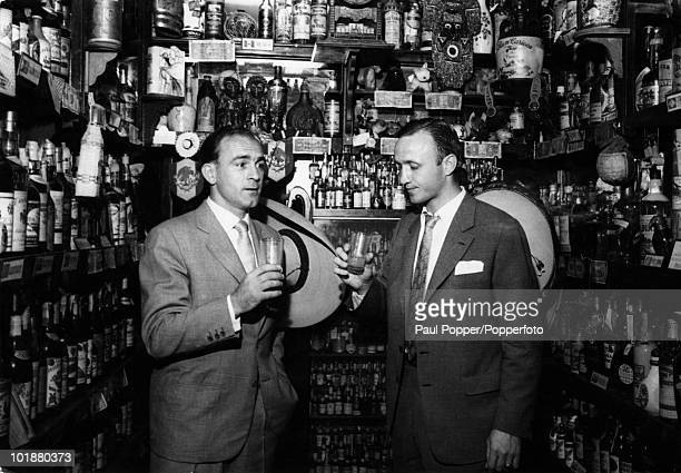 ArgentineSpanish footballer Alfredo di Stefano of Real Madrid attends a party in the wine cellar of Perico Chicote in Madrid 11th June 1959 The party...