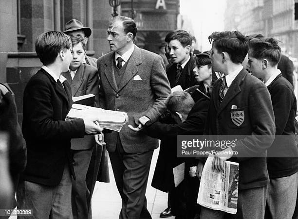 ArgentineSpanish footballer Alfredo di Stefano of Real Madrid is besieged by schoolboy fans outside his Manchester hotel 24th April 1957 Tomorrow he...