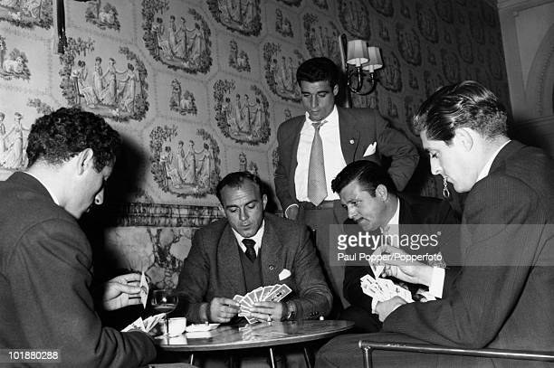 Argentine-Spanish footballer Alfredo di Stefano of Real Madrid relaxes with fellow team members at their Manchester hotel, 25th April 1957. Later,...