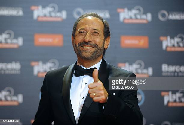 Argentinian actor Guillermo Francella gives the thumb up as he arrives for the Platino IberoAmerican Film Awards in Punta del Este Uruguay on July 24...