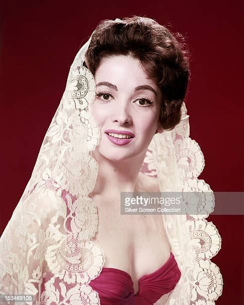 Argentinian actress Linda Cristal wearing a white lace veil in a publicity portrait for the American TV western series 'The High Chaparral' circa...