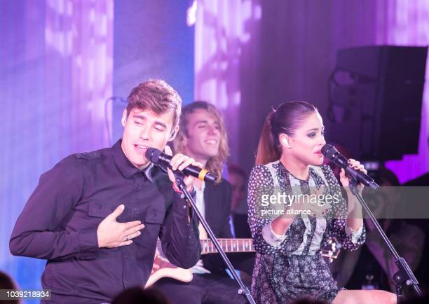 Argentinian actress Martina Stoessel her Mexican actor colleague Jorge Blancoat during a Disney song as part of an exclusive concert on the occasion...