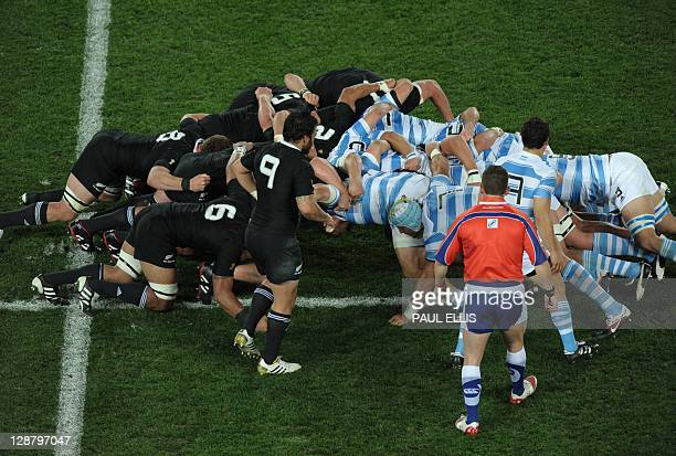 Argentinian and All Blacks players engage in a scrum during the 2011 Rugby World Cup quarterfinal match New Zealand vs Argentina at the Eden Park in...