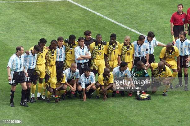 Argentinian and Jamaican players pose together for an unusual official team picture 21 June at the Parc des Princes stadium in Paris before their...