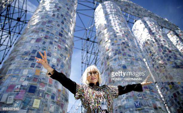 TOPSHOT Argentinian artist Marta Minujin poses in front of the 'Parthenon of Books' at the Documenta 14 art exhibition in Kassel on June 7 2017 The...