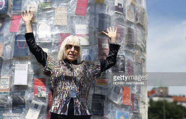 Argentinian artist Marta Minujin poses inside the 'Parthenon of Books' at the Documenta 14 art exhibition in Kassel on June 7 2017 The Parthenon of...