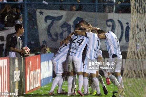 Argentinian Atletico Tucuman players celebrate a goal against Bolivian Wilstermann during their Libertadores Cup football match at the Jose Fierro...