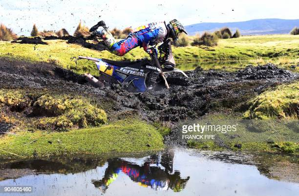TOPSHOT Argentinian biker Franco Caimi crashes during Stage 7 of the 2018 Dakar Rally between La Paz and Uyuni Bolivia on January 13 2018 / AFP PHOTO...