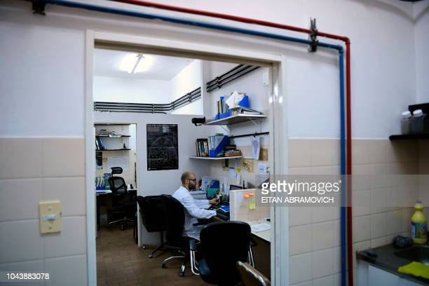 Argentinian Biotechnologist and grant holder of the National Scientific and Technical Research Council Gaston Amable conducts a research at the...