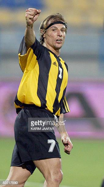 Argentinian Claudio Caniggia jubilates after scoring the second goal for his team Qatar against alSailiyah club during a match in Doha 06 February...