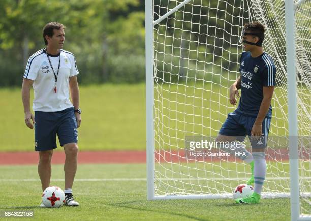 Argentinian coach Claudio Ubeda speaks with Lautaro Martinez of Argentina during an Argentina training session at the Jeonju World Cup Stadium...