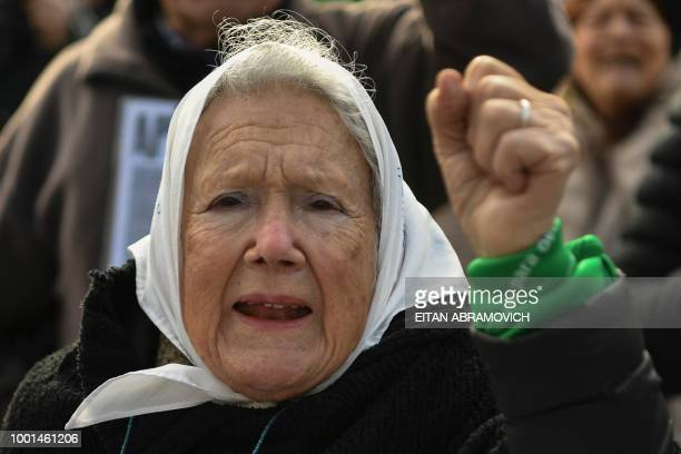 Argentinian cofounder of the 'Madres de Plaza de Mayo' human rights association Nora Cortinas wears a white symbol of the organization and a green...