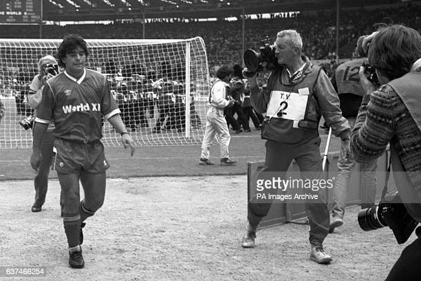 Argentinian Diego Maradona walks off the pitch after his Rest of the World XI side lost 1-0