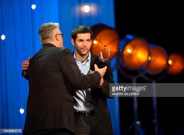 Argentinian director Benjamin Naishtat receives the 'Concha de Plata' best director award for his film 'Rojo' during the 66th San Sebastian Film...