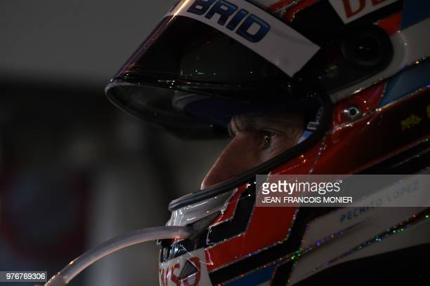 Argentinian driver Jose Maria Lopez waits to relay his copilot in their Toyota TS050 Hybrid LMP1 during the 86th Le Mans 24hours endurance race at...