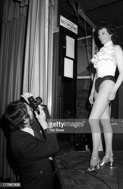 Argentinian exotic dancer Fanne Foxe poses for American photographer Tim Boxer from the stage at the Riverboat nightclub during rehearsals for her...