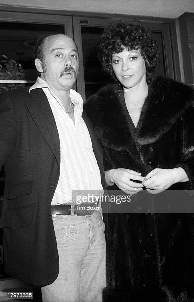 Argentinian exotic dancer Fanne Foxe poses with producer Bob Cherin at a performance of the Cherin's cabaret show 'Pouff' at La Vie En Rose New York...