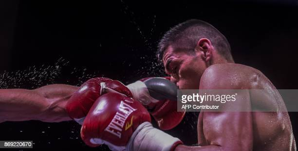 TOPSHOT Argentinian Fabian Maidana absorbs a blow from Venezuelean Johan Perez during their welterweight boxing match at the Macarena Event Center in...