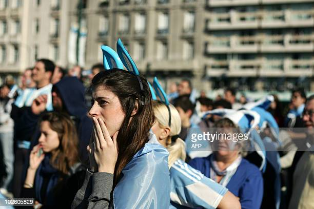 Argentinian fans watch the South Africa 2010 World Cup match against Germany on an outdoor screen in Buenos Aires Argentina on July 3 2010 AFP PHOTO/...