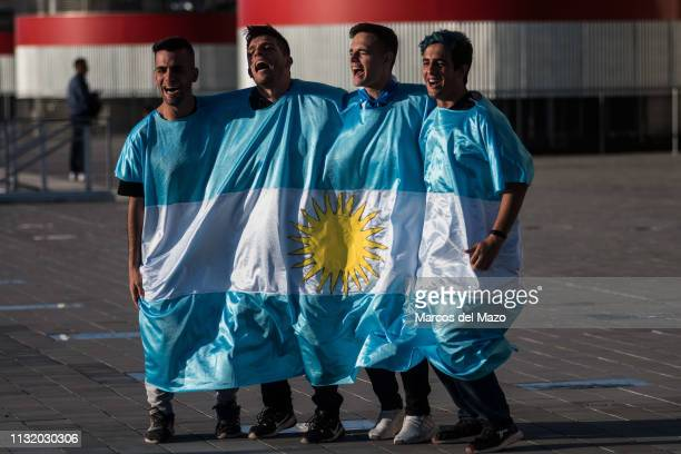 Argentinian fans wrapped with Argentina flag shouting ahead of friendly football match between Argentina and Venezuela in Wanda Metropolitano Stadium