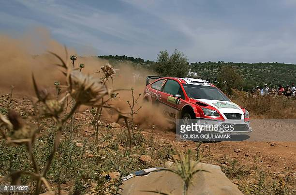Argentinian Federico Villagra and JoseMaria Volta drive their Ford Focus RS at Aghia Trada special stage of the second leg of the Acropolis rally in...