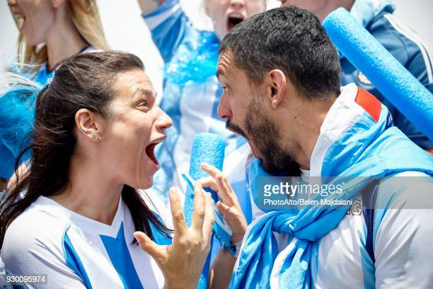 Argentinian football fans shouting excitedly at match