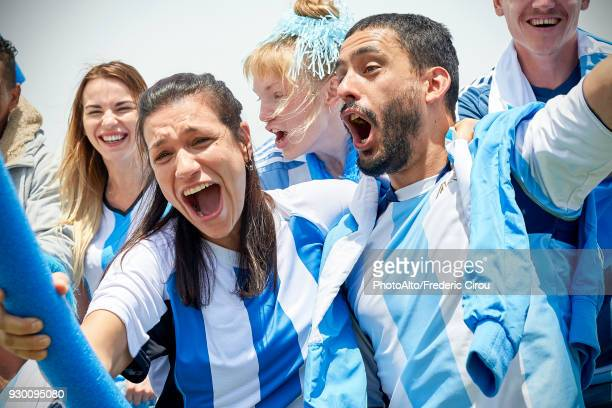 argentinian football fans watching football match - argentina women stock pictures, royalty-free photos & images