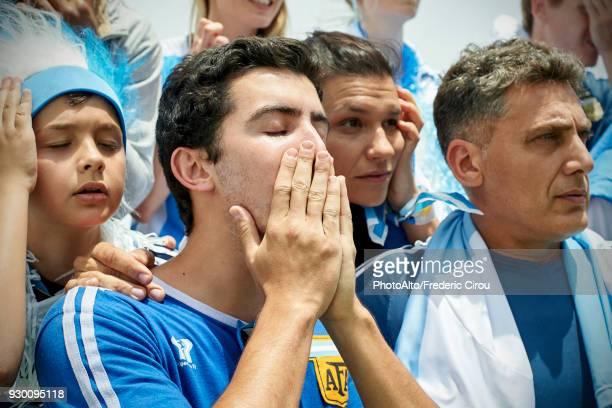 argentinian football fans watching football match - 数人 ストックフォトと画像